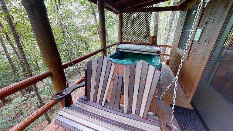 Hocking Hills Cabins Anniversary swing and hot tub