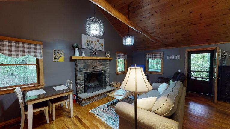 Hocking Hills Cabins Nestled Away couch and fireplace