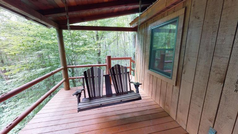 Hocking Hills Cabins Sweet Seclusion swing on deck